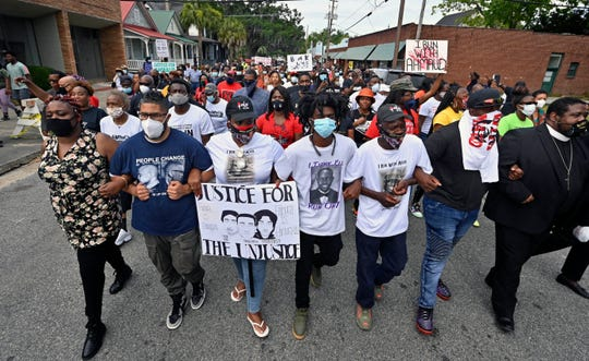 Protesters march after a rally at the Glynn County Courthouse on Saturday to protest the shooting of Ahmaud Arbery in Brunswick, Ga.