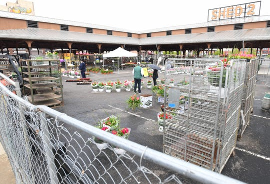 Only a few flower vendors and a scattering of people were at Eastern Market on  Sunday.
