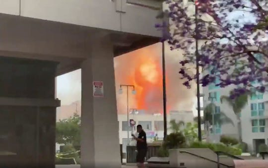 In this screen grab from video,  flames from an explosion are seen Saturday, May 16, 2020, in Los Angeles.