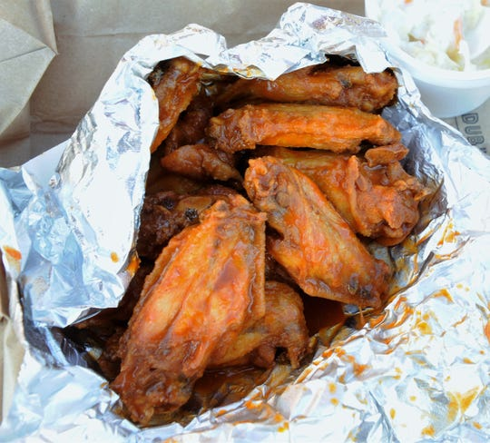 A dozen spicy hot wings with a side of creamy slaw from John Earl's in Henderson.