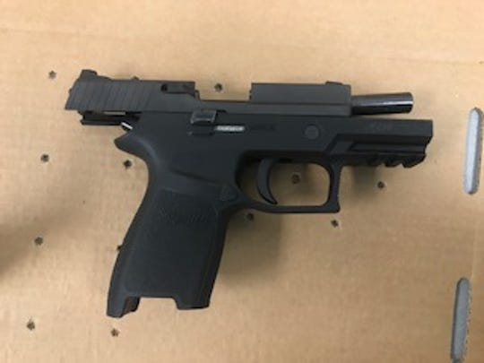 A  Sig Sauer .380 firearm taken from a student at Harns Marsh Middle School in December. A vice principal has been reprimanded and demoted for how she handled the situation.