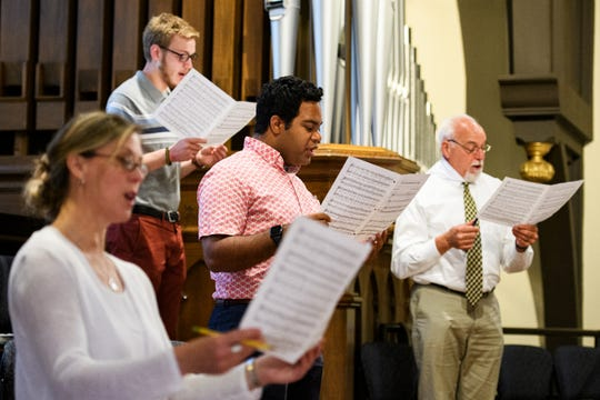 Members of the choir rehearse before at St. Mary's Catholic Church before their first in-person mass since the beginning of the novel coronavirus pandemic Sunday, May 17, 2020.