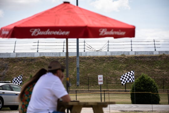 Patrons seated at the Raceway Grill outside Darlington Speedway before the start of the Real Heroes 400, Sunday, May 17, 2020, the first race since the season was postponed due to the coronavirus epidemic