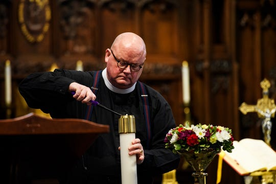 Father Jay Scott Newman prepares for an in-person mass at St. Mary's Catholic Church Sunday, May 17, 2020. The church held in-person mass for the first time since the beginning of the novel coronavirus pandemic.