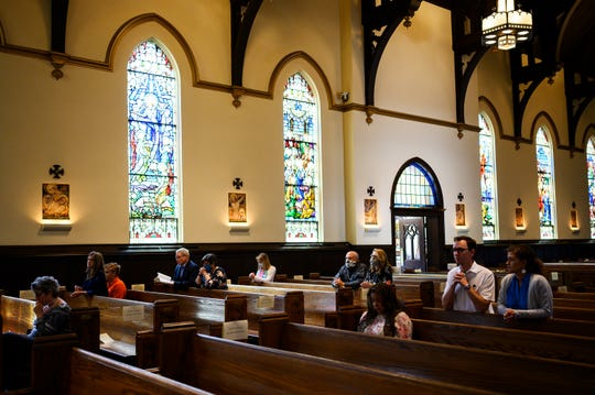 Congregants sit in the pews at St. Mary's Catholic Church for the church's first in-person mass since the beginning of the novel coronavirus pandemic Sunday, May 17, 2020.