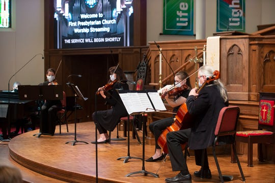 A reduced orchestra performs Sunday,  May 17, 2020, for the first in-person traditional services at First Presbyterian in Greenville, South Carolina, since the COVID-19 outbreak in early March.