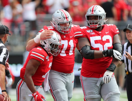 Ohio State running back J.K. Dobbins celebrates a touchdown last year against Cincinnati with center Josh Myers and guard Wyatt Davis