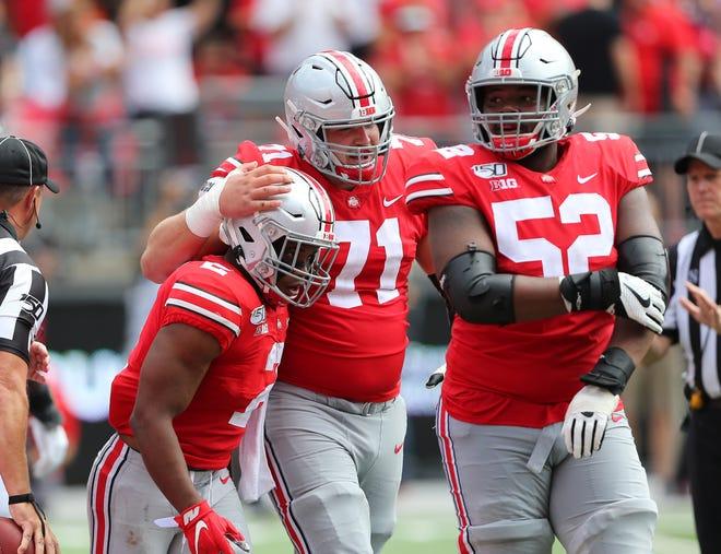 Ohio State running back J.K. Dobbins celebrates a touchdown last year against Cincinnati with center Josh Myers and guard Wyatt Davis