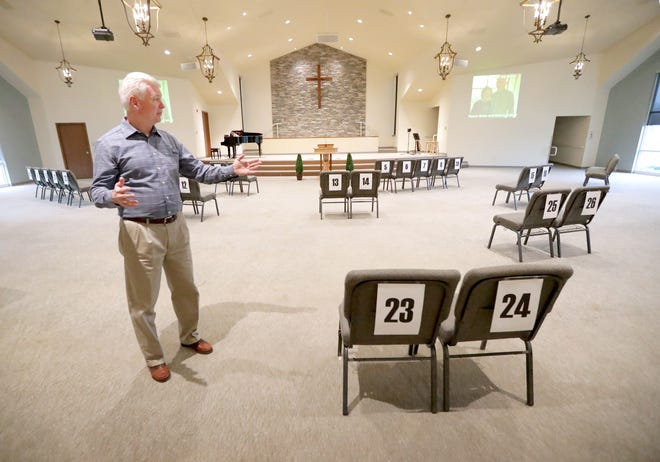 """It was so warm and refreshing to see people,"" Lakewood Baptist Church Pastor Brian Trainer said as he shows how he kept parishioners socially distant with reserved seating for services at the church in Pewaukee on Sunday, May 17, 2020. Some church services resumed in-person worship services for the first time since the coronavirus pandemic and following the state Supreme Court ruling that overturned Gov Tony. Evers' statewide stay-at-home orders."