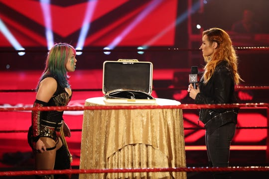 """WWE RAW women's champion Becky Lynch, right, announced on this past Monday's """"RAW"""" that she's pregnant, and as a result, Asuka, left, became the new champion due to her Money in the Bank win."""