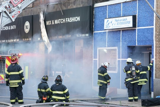 Firefighters battling a two-alarm fire on Main Street at Salem Street in Hackensack, NJ that took place around 5:45 p.m. on May 16, 2020.