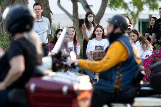 Family and friends watch people drive-thru in memorial of Madalyn Slater, the one-year-old girl killed recently, held at Southwest Church in Indian Wells, Calif., on Saturday, May 16, 2020.