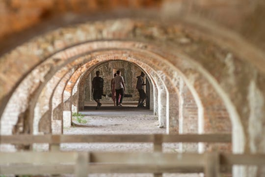 Visitors enjoy the sunshine and warm weather at Fort Pickens Sunday, May 17, 2020.