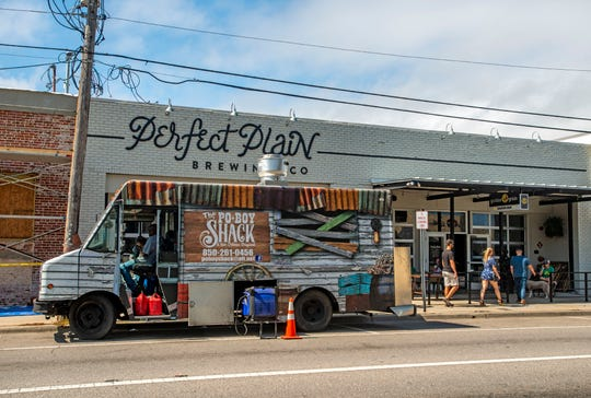 The Po-Boy Shack food truck is stationed outside Perfect Plain Brewing Co on Sunday. Perfect Plain re-opened its Garden & Grain outdoor cocktail lounge Saturday with limited capacity under guidance from the Florida Brewers Guild.