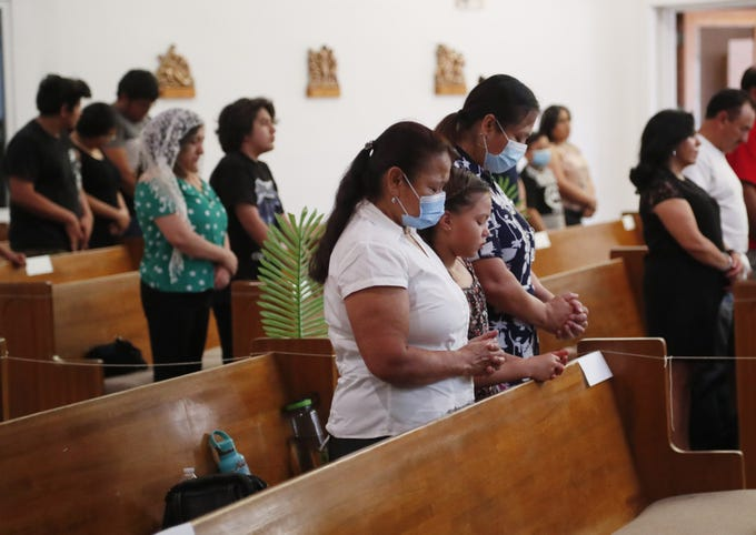 Parishioners attend Mass at St. Luke Catholic Church in Phoenix May 17, 2020. The church resumed services limited to 25% capacity after state restrictions due to the coronavirus were allowed to expire.