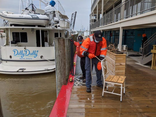 The St. Clair County Dive Team pulled over a dozen CityFlatsHotel and Fair Weather Grill chairs from the Black River in Port Huron on May 17, 2020.