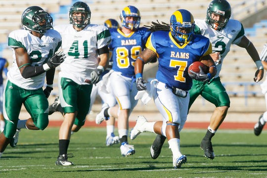 Angelo State University's Tristan Carter runs the ball down the field during the first quarter against Eastern New Mexico at San Angelo Stadium on Sept. 4, 2010.