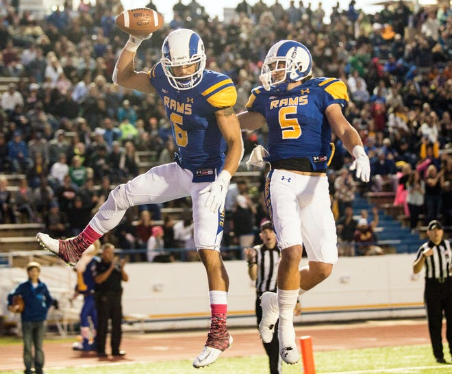 Angelo State University's Dakarai Pecikonis (left) and teammate Brett Rasberry celebrate in the end zone after Pecikonis made a catch for a touchdown during their matchup against Texas A&M-Commerce on Oct. 11, 2014.