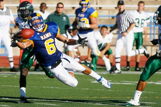 Angelo State wide receiver Dakarai Pecikonis stretches for a one-handed catch against Eastern New Mexico on Sept. 4, 2010.