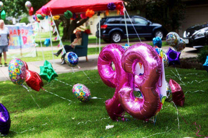Dozens participate in a birthday parade for Pauline Medley in Springfield May 17, 2020. The soon-to-be 93-year-old has been in quarantine since March due to health concerns. Her granddaughters helped put together a special celebration.
