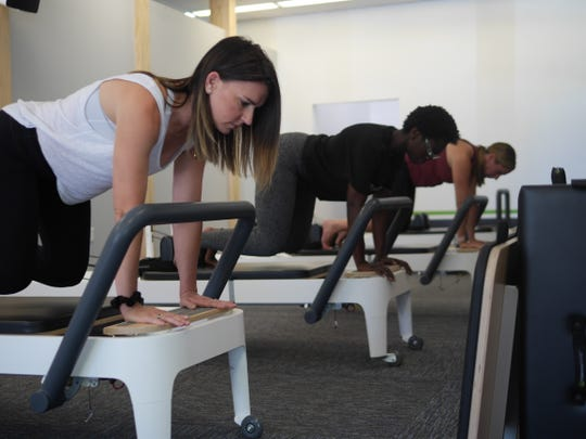 Erin Wilder and Sarah Hickman workout with instructor Chantell Bell, center, at Fit & Functional.