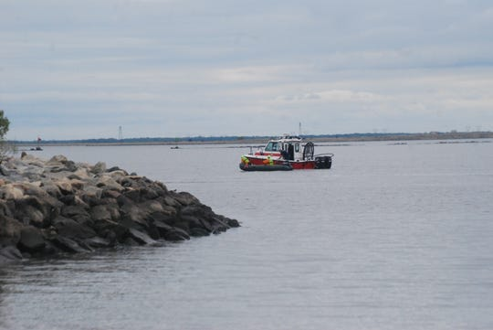 The Coast Guard searched the Delaware River for 18 hours starting Friday night after a boat capsized near Augustine Beach. One boater was not found.
