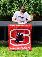 Luken Hill, of Sheridan, signs his letter of intent with Concord University. Hill was part of teams that won 61 games in three years.