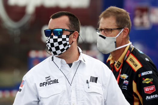 A NASCAR official with a mask looks on prior to the NASCAR Cup Series The Real Heroes 400 at Darlington Raceway on May 17, 2020 in Darlington, South Carolina.