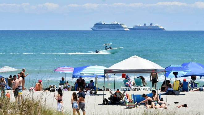 People enjoy the sun and sand at Lori Wilson Park in Cocoa Beach on May 2, 2020. Although spring break hotspot, restrictions continue at Cocoa Beach, allowing only groups of five or less.