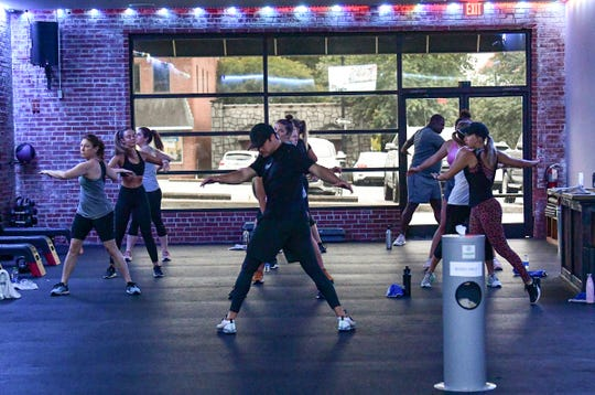 Grant Cox, middle, a fitness trainer, leads a class at The Junkyard fitness in Anderson Monday, May 18, 2020. Gyms, salons, tattoo parlors and other close-contact businesses in the Upstate opened their doors Monday after an executive order closing them was lifted in South Carolina.