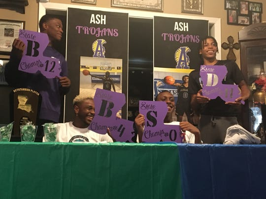 """Alexandria Senior High's Latrell Holly (second left) and Eric Speed (second right) signed to Spoon River College and Texas A&M of Texarkana, respectively, Sunday. From left are ASH's basketball senior signees Jadarius """"Bud"""" Clark, Holly, Speed and Dez McQuain."""