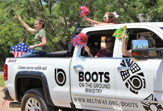 Rah-rah-raydo, one year since the tornado - a Boots on the Ground vehicle participates in Monday's Honk Your Horn parade through storm-damaged neighborhoods. Boots on the Ground volunteers are building a tiny home for storm victim Luz Rodriquez on South Second Street.