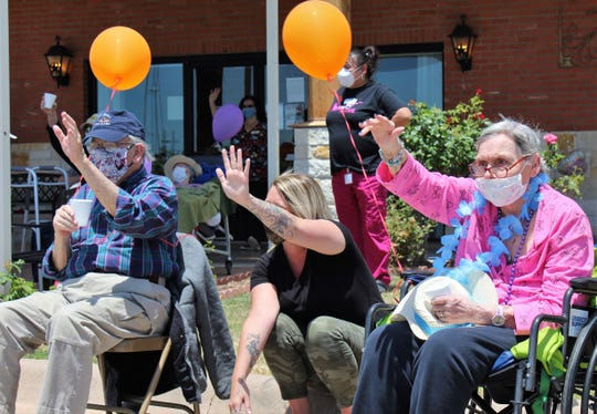Two residents of Willow Springs Health & Rehabilitation Center were among 12 who braved the sun and warming temperatures to enjoy Monday's Honk Your Horn parade on the first anniversary of the 2019 tornado in Abilene. Willow Springs sustained damage, and a U-Haul trailer from across the Winters Freeway was blown on to the property.