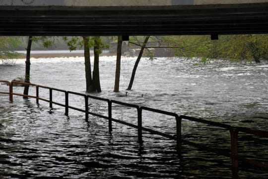 A section of Linear Trail under the Emmett Street bridge near the Verona Dam is completely submerged under water on Monday, May 18, 2020.
