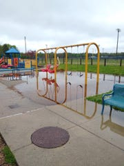 Flooding at ANYbodies playground at Bailey Park in Battle Creek on Monday, May 18, 2020.