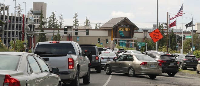 FILE - Vehicles along Suquamish Way merge into traffic heading into Clearwater Casino Resort as the facility reopened in May after weeks of being closed because of the COVID-19 outbreak.