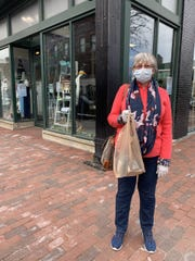Nancy Carey, who has been waiting to get to Tick Tock Jewelers for watch repair, poses on Church Street the day Vermont allowed retail businesses to reopen. May 18, 2020.