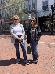 Debbie Thibault and Andrea Foster get out to Church Street as retail stores open in Vermont. Foster picked up an order from Garcia's Tobacco Shop. May 18, 2020.