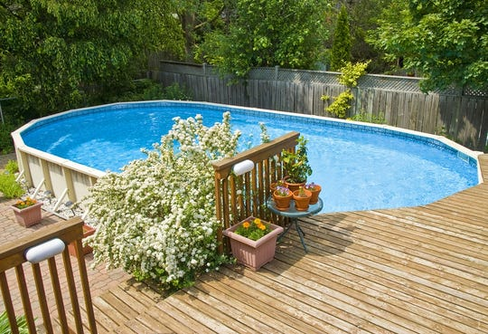 An above-ground pool and deck.