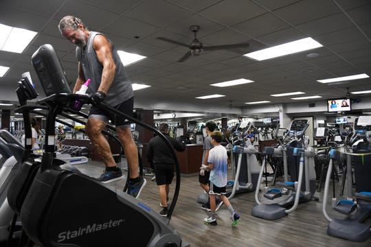 "Ron Bohannan uses the stair master machine, Monday, May 18, 2020, at Corpus Christi Athletic Club. Bohannan says that he's ""thrilled to death"" that the gym has reopened."