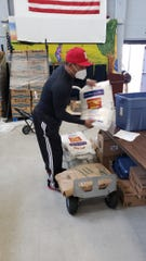 Rogelio Nunez loads supplies for those in need during his new role with the Perth Amboy Department of Recreation during the COVID-19 pandemic.