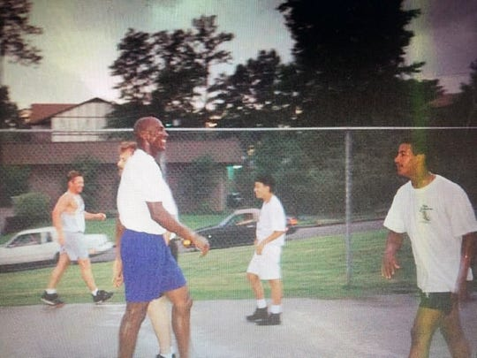 Rogelio Nunez, right, played pickup basketball with Michael Jordan during the summer of 1994.