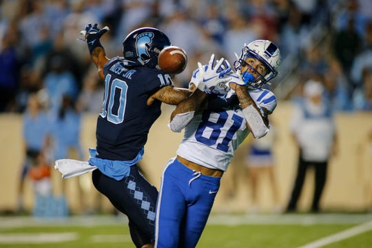 North Carolina Tar Heels defensive back Greg Ross (10) disrupts a catch by Duke Blue Devils wide receiver Aaron Young (81) in the second half at Kenan Memorial Stadium on Oct. 26, 2019.