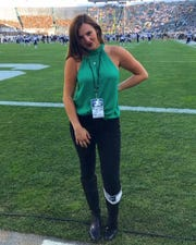 Annie Agar poses on the field at Spartan Stadium.