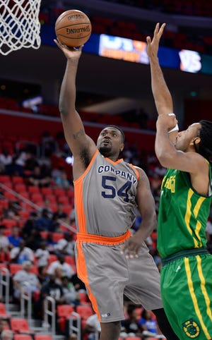 3's Company Jason Maxiell scores over Ball Hogs' Josh Childress in the first half of a 2018 Big3 game at Little Caesars Arena in Detroit.