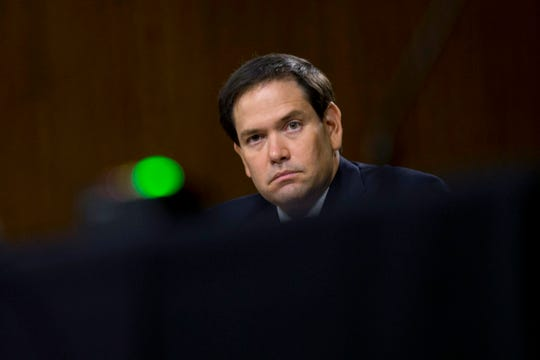 Sen. Marco Rubio, R-Fla., listens during a Senate Intelligence Committee nomination hearing.