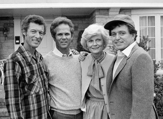 """This Dec. 10, 1982 file photo shows members of the original cast of the """"Leave It To Beaver,"""" from left,  Ken Osmond, Tony Dow, Barbara Billingsley and Jerry Mathers during the filming of their TV special, """"Still The Beaver,"""" in Los Angeles."""