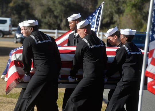 In this Dec. 16, 2019 file photo, sailors carry the casket of Cameron Walters at Oak Hill Cemetery in Richmond Hill, Ga. Walters was one of the three Navy sailors killed in a Saudi gunman's attack at Pensacola Naval Air Station in Florida on Dec. 6.