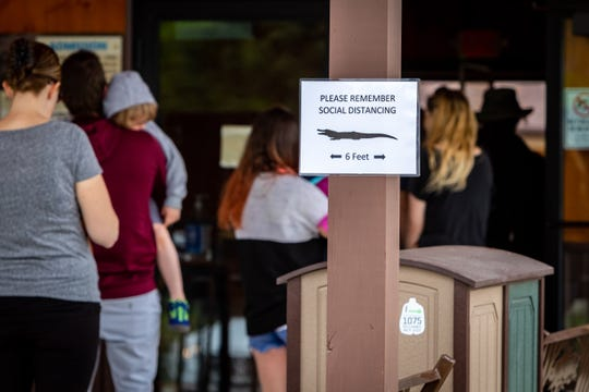 Social distancing rules are posted at the entrance to the Boulder Ridge Wild Animal Park, May 16, 2020. Despite Governor Whitmer's executive order for nonessential businesses to remain closed until May 28, 2020, the park reopened May 15.