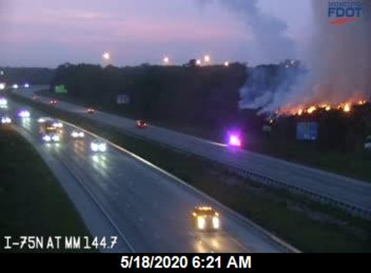 A fire remained burning Monday in piles of agricultural debris at MW Horticulture Recycling was being battled by North Fort Myers fire crews.